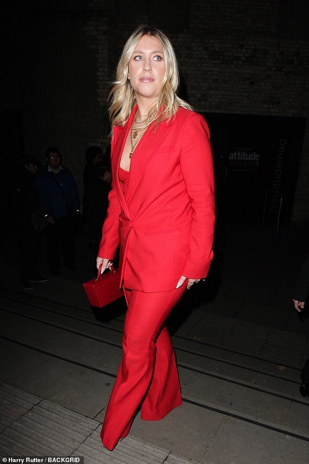 Red lady: Her blonde locks were worn out in loose beachy waves while she went for natural dewy make-up to highlight her pretty features