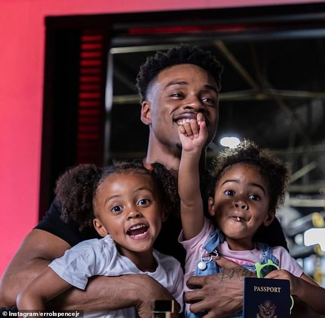 Spence is pictured with his two daughtersIvy and Violet in September. He has never discussed his marital status or the identity of the girls' mother