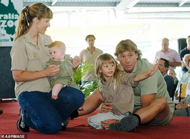Family: Bindi said she will light a candle alongside her mother Terry and brother Robert and share 'a few words on what an amazing dad he was' (Pictured with her parents and brother in 2004)