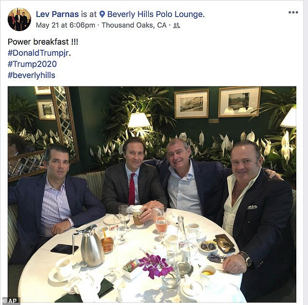 This Facebook screen shot provided by The Campaign Legal Center, shows from left, Donald Trump, Jr., Tommy Hicks, Jr., Lev Parnas and Igor Fruman, posted on May 21, 2018