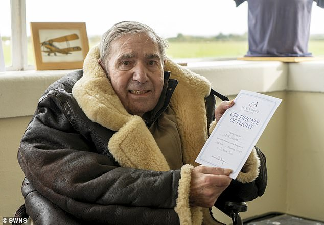 Proud as punch! Spike is pictured above with his certificate of flight following his epic journey