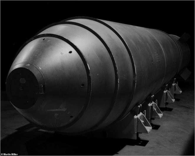 The Mark 17 Thermonuclear bomb has been photographer by Miller in intricate detail. Five of the bombs were added to the United States' nuclear arsenalbetween April and October 1954. However, in May 1957, one of the large weapons accidentally fell from a plane as it was being carried over an Air Force Base in New Mexico. The device accidentally fell through closed doors of a B-36 bomber as it was in the process of landing. Plutonium pits were stored separately on the plane as a safety measure, meaning that a nuclear disaster was avoided. However, the incident spread radioactive contamination for more than a mile around its impact zone. The Mark 17's were subsequently taken out of service later that year.