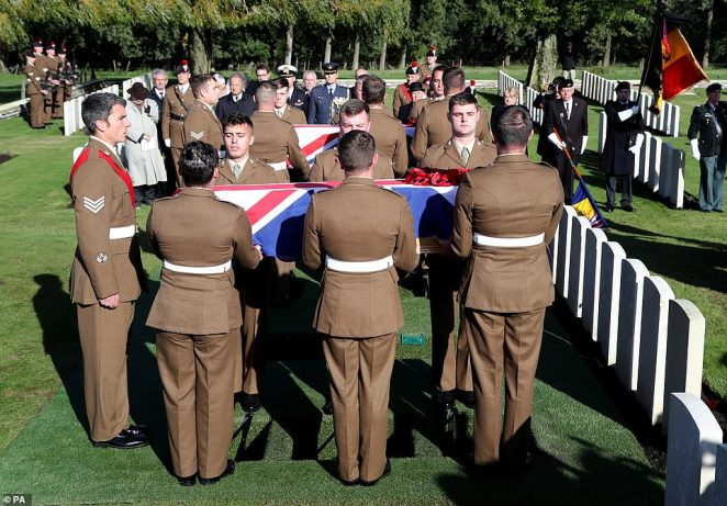 Coffins arriving for a burial service at the Commonwealth War Graves Commission's Wytschaete Military Cemetery, near Ypres, Belgium, for thirteen unknown soldiers who died fighting in Belgium in the First World War