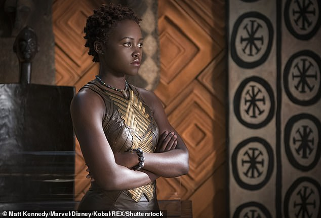 She said: 'I definitely grew up feeling uncomfortable with my skin colour because I felt like the world around me awarded lighter skin' (pictured in 2018's Black Panther)