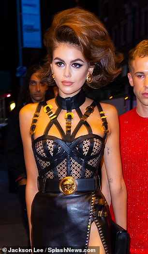 Bondage babe: She attended her New York City party in a strappy black leather dominatrix look by Versace