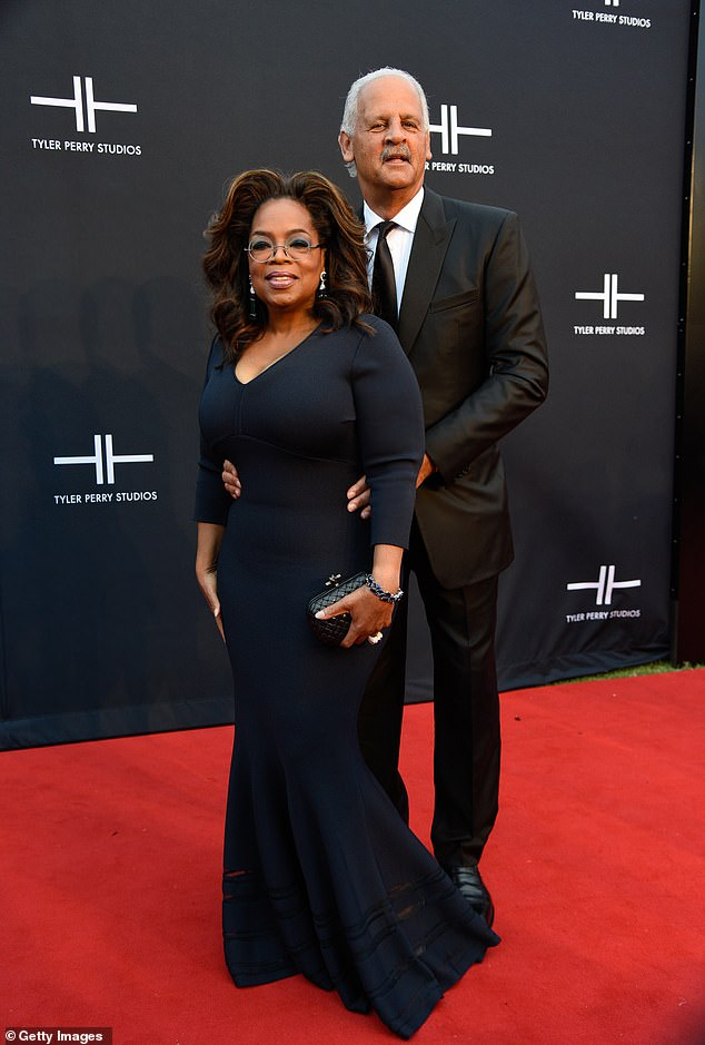 Still thriving: Oprah and Stedman had fun with a prom pose on October 5 in Atlanta
