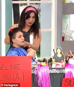 Contestants: The other hair dressers and their respective models stare awkwardly asİlayda broke down