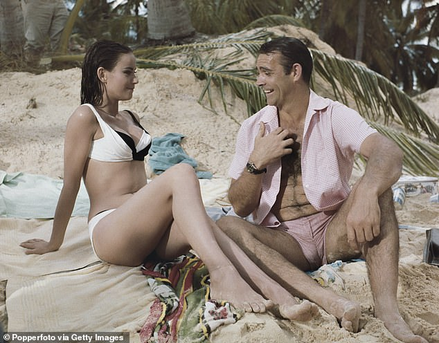 Scottish actor Sean Connery and French actress Claudine Auger on a beach in the Bahamas in 1965 during filming for James Bond film Thunderball