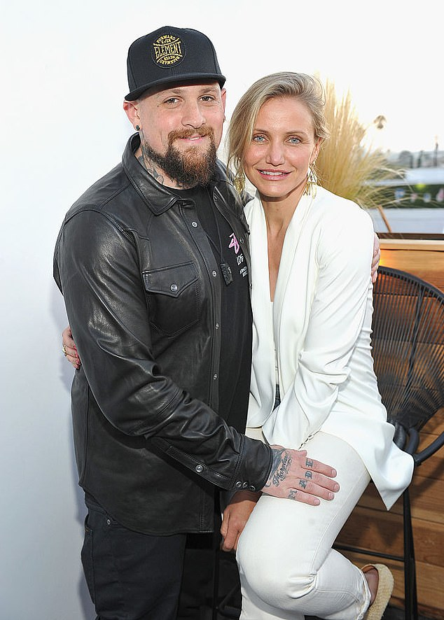 So sweet: Cameron has been married to Benji Madden of Good Charlotte fame since 2015; they are pictured the following year in LA