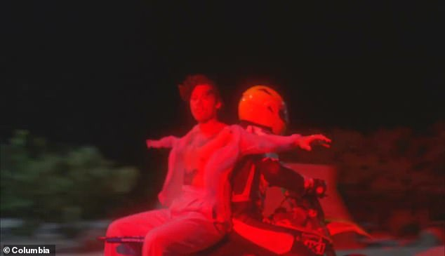 Daredevil: Harry was also seen riding the back of a motorcycle as he sang the catchy tune