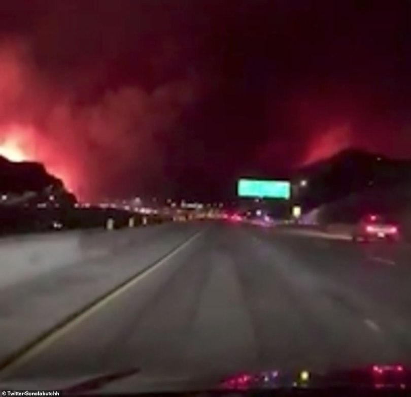 Shocking videos show residents driving along as the massive wildfire spreads on both sides of them in Saddleridge, Sylmar near Los Angeles on Thursday night