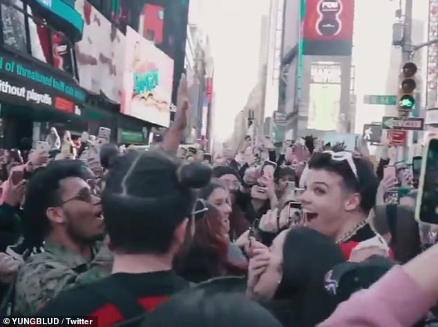 The rapper was mobbed by adoring fans who filmed the wild scenes in New York on the phones