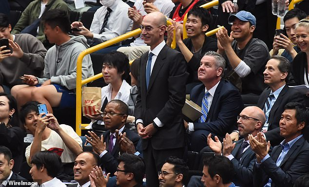 NBA commissioner Adam Silver (standing), speaking in Japan before a preseason game between the Rockets and Toronto Raptors, said it was not up to the league to regulate what players, employees and team owners said. Silver said on Tuesday the league supported Morey's right to exercise his freedom of expression, further angering authorities and some fans in China and threatening the NBA's business there, said to be worth more than $4 billion