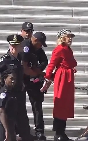 Fonda was led away by police on Friday. Her hands appeared to be zip-tied