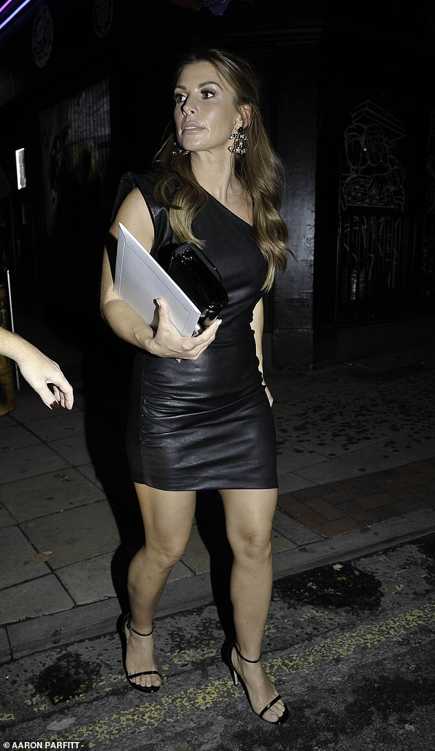 Sexy:She teamed her sexy frock with a pair of barely-there black heels, which boosted her petite frame as she strutted into the star-studded bash