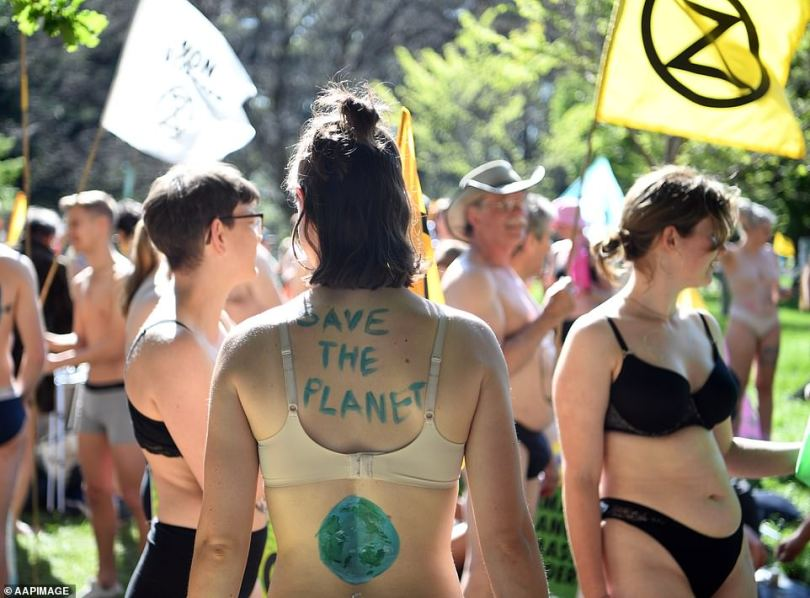 As part of Melbourne's Nudie Parade, protesters 'put it all on display' as they stripped down to their underwear and painted climate change messages on their bodies