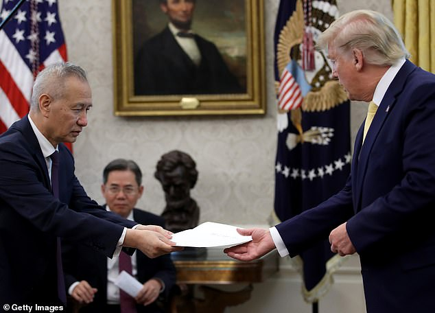 Chinese Vice-Premier Liu He presents a letter from Chinese President Xi Jinping to US President Donald Trump after Trump announced a first phase trade agreement with China