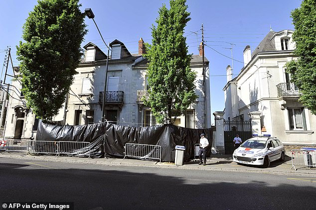 In this file, taken on April 22, 2011, French police guarded the Dupont de Ligonnes family home in Nantes, western France after the French authorities issued an international search alert for Xavier Dupont de Ligonnes
