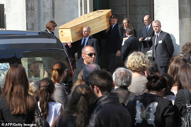 During the funeral, people hold the coffin of a member of the Dupont de Ligonnes family in their hands