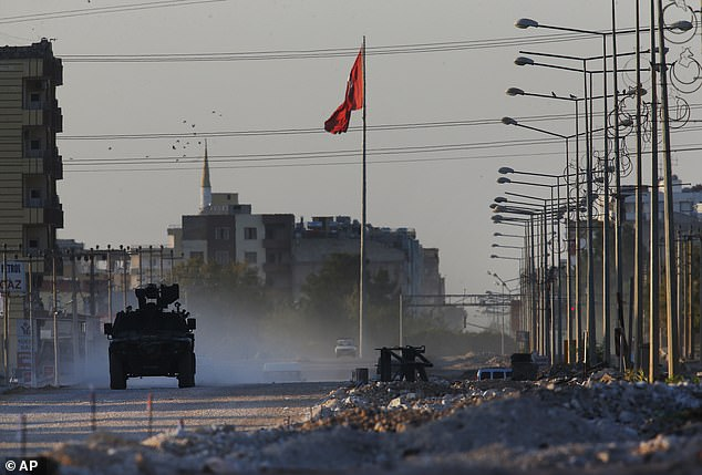 A Turkish police armored vehicle patrols the town of Akcakale, Sanliurfa province, southeastern Turkey, at the border with Syria