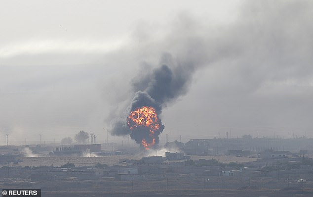 An explosion over the Syrian town of Ras al-Ain as seen from the Turkish border town of Ceylanpinar, Sanliurfa province on Saturday
