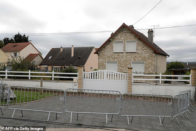 Barriers placed at the front of a house in Limay, north-west of Paris, which is said to be the home of the man arrested late October 11 at Glasgow Airport