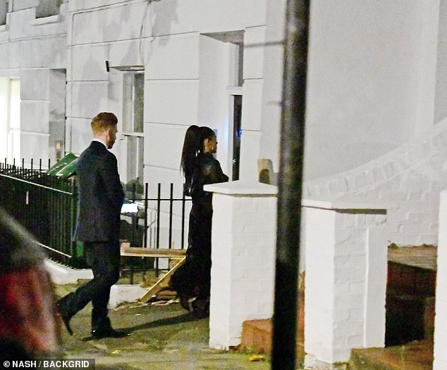 Dancing pair: Neil waited a few steps behind Alex as she opened the door to her London home
