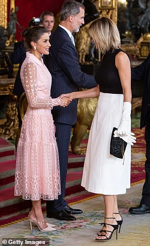 Queen Letizia of Spain (left) and Spanish TV presenter Susanna Griso (right) attended a reception at the Royal Palace during the National Day