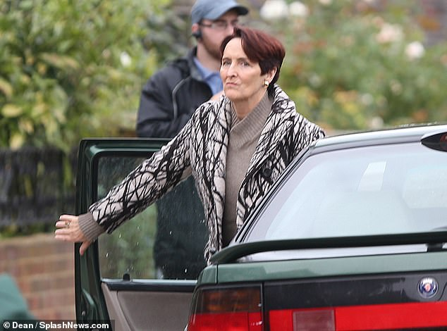 Our exclusive pictures reveal that her intended quarry in the upcoming third series of the hit spy thriller is Machiavellian spy boss Carolyn Martens, played by Fiona Shaw, who is pictured above getting out of a car
