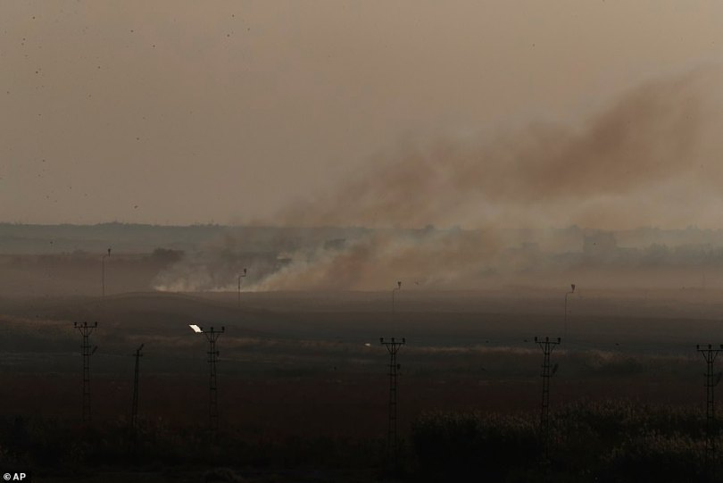 Smoke billows from Tel Abyad in Syria on Saturday in a photograph taken from the Turkish side of the border