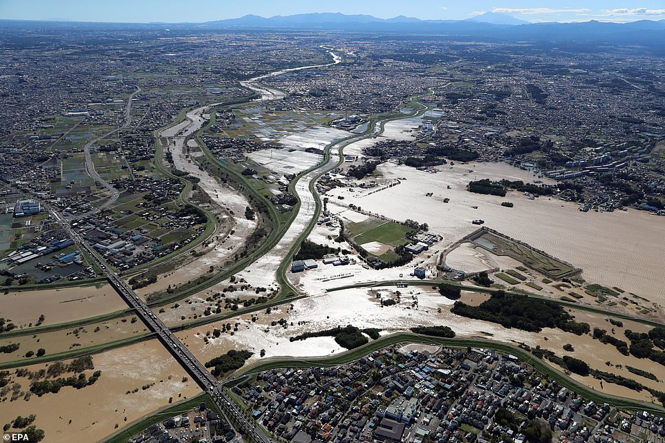 Vast areas are covered in flood water on Sunday in Kawagoe, Saitama prefecture, Japan, as the death toll continues to rise
