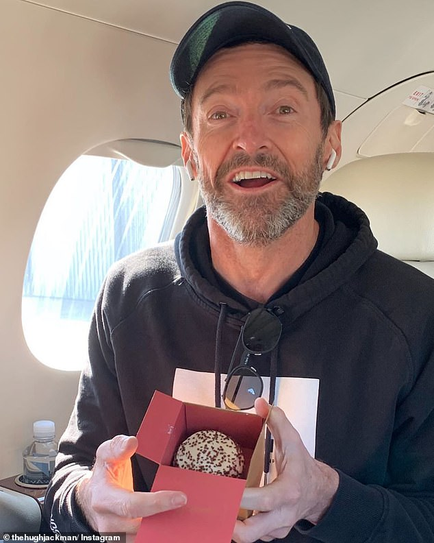 'Thank you for ALL the awesome birthday messages': Earlier in the day, Hugh Jackman (pictured) star shared a photo of him holding a cupcake, and thanked fans for their messages