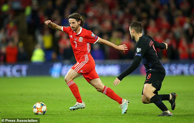 A booking for Joe Allen means he will not feature in Azerbaijan (Nigel French/PA)