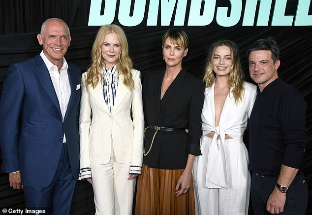 The Bombshell team: The three headlining actresses from the film were joined by Lionsgate execsJoe Drake (left) andDamon Wolf (right)