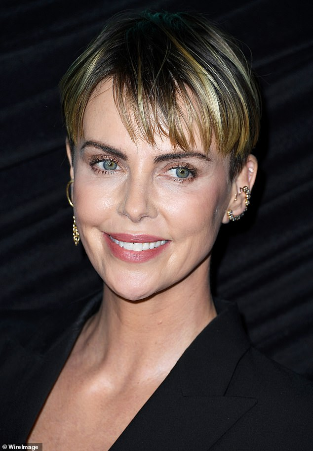 Timeless and gorgeous:Theron was still sporting her short pageboy haircut