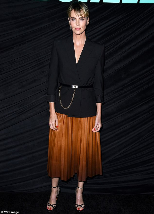 Halloween colors:Charlize complimented Nicole and Margot by also wearing a blazer, but in the opposite shade of black