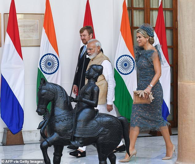 Following their initial meeting, the Queen Maxima, who accessorised her elegant dress with a brown clutch bag by her side and a pair of nude heels, walked with the Indian Prime Minister and her husband