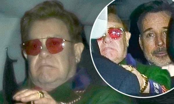 Elton John cuts a glum figure after night out with David Furnish