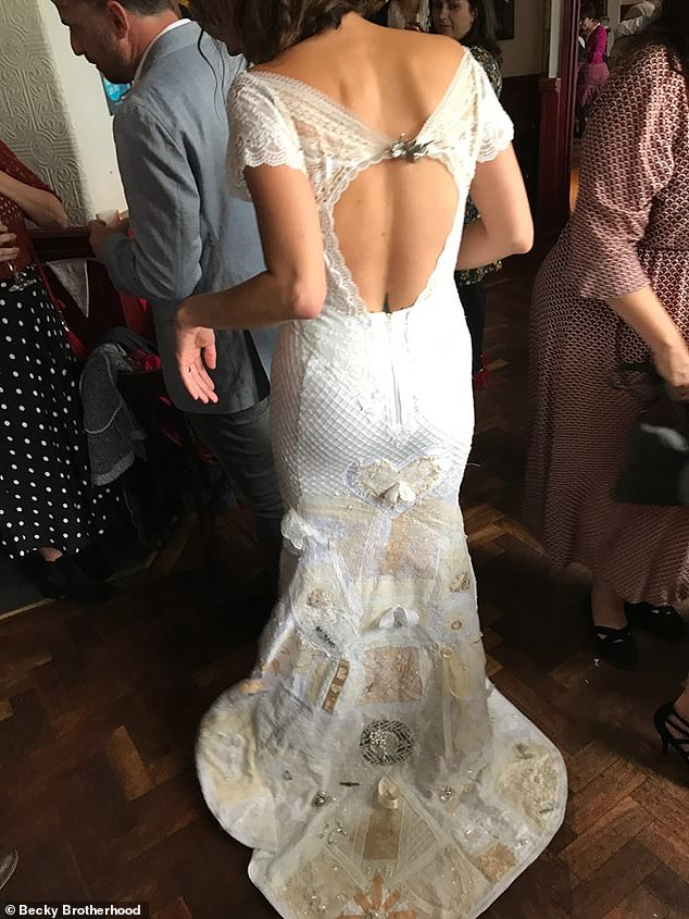 The creative bride admits the patches and the whole process means 'the absolute world' to her. Pictured, showing the patches on the bottom of her dress
