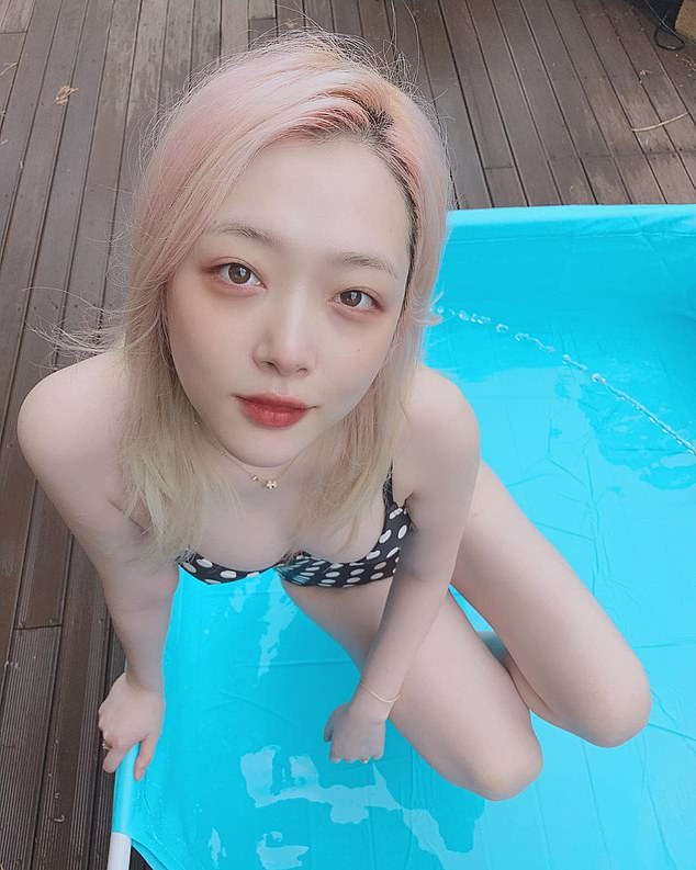 Sulli, pictured, reportedly ended her music career after suffering from abuse on social media