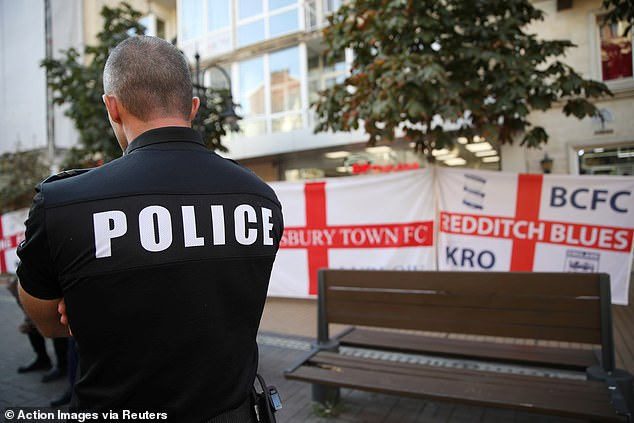 A police officer stands watch in Sofia, Bulgaria, prior to the game with England on Monday