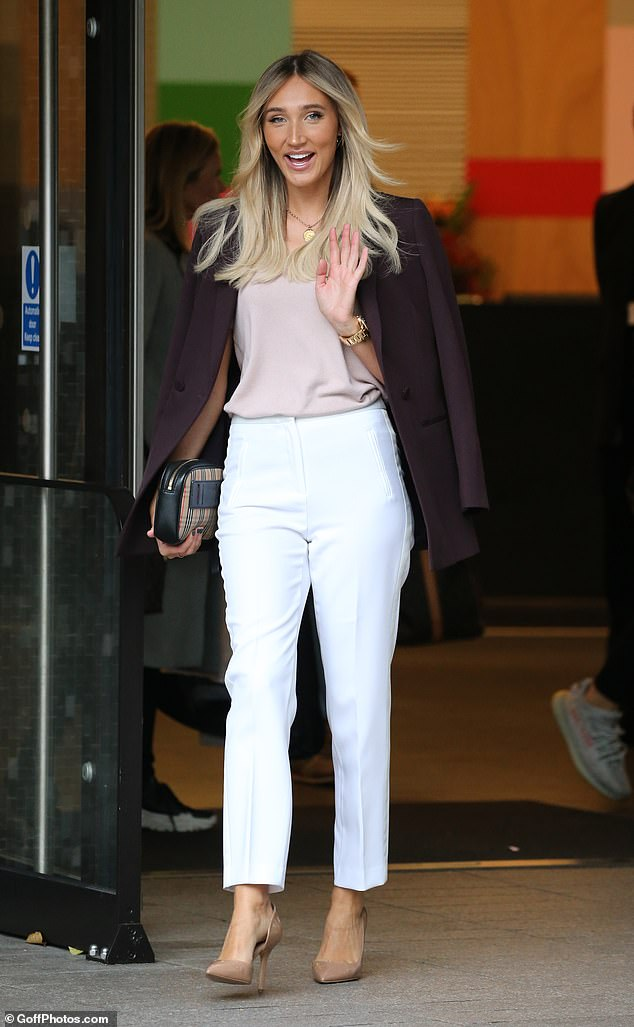 Stylish: Megan McKenna, 27, oozed elegance in a pair of tailored white trousers and nude heels as she left the ITV London Studios on Tuesday after appearing on Good Morning Britain
