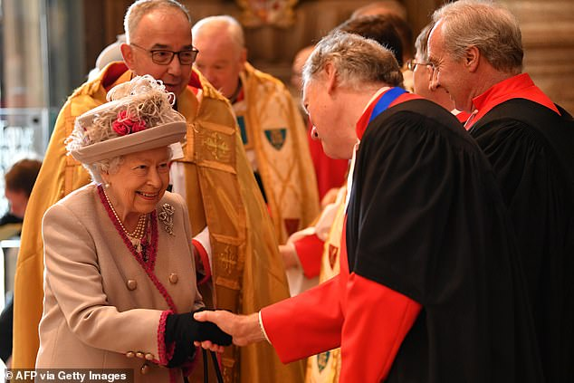 The Queen smiled broadly as she met with members of the clergy ahead of the anniversary service today