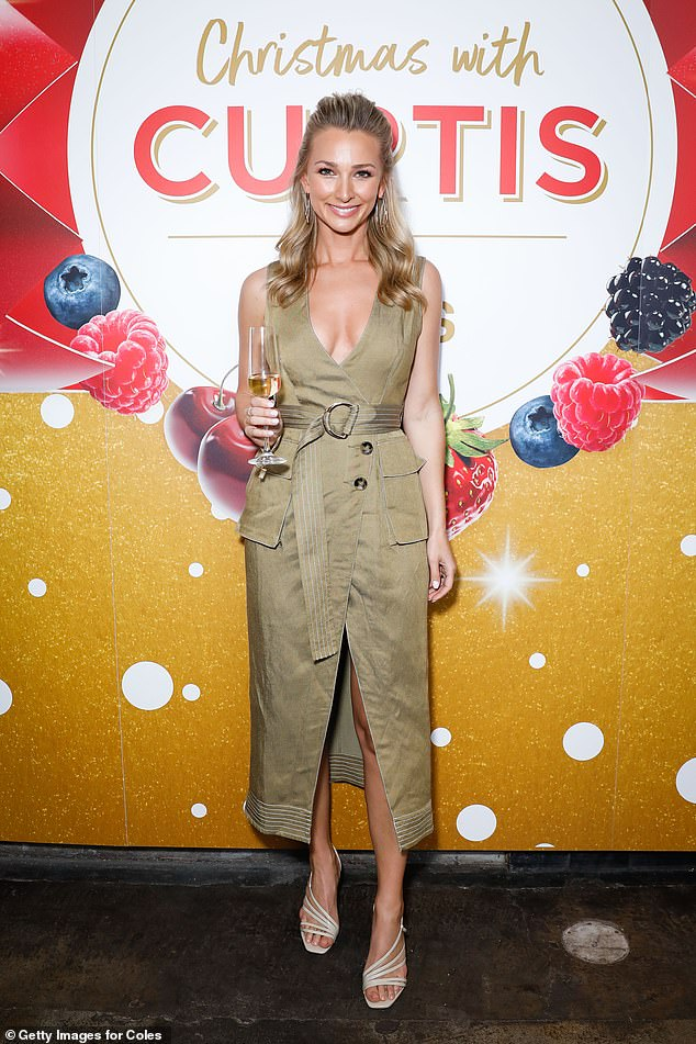Serving looks! Anna Heinrich (pictured) showed off her sensational figure in a khaki trench coat dress, as she led the arrivals at Curtis Stone's Christmas event in Sydney on Tuesday