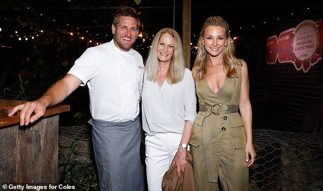 Company: Anna brought her mother Judy Heinrich (centre) along for the occasion, and the duo posed for a photo with Curtis Stone (left), 43