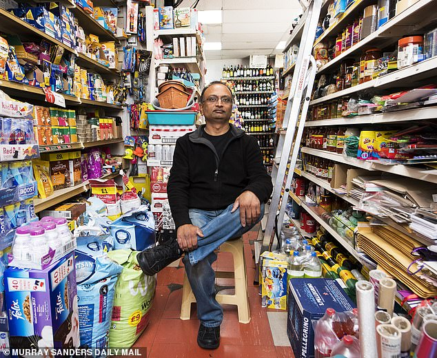 The writer of the note, the son and co-owner of this family-run shop, whom I've only ever known as Mr Patel (pictured), was standing behind the counter looking a bit shell-shocked