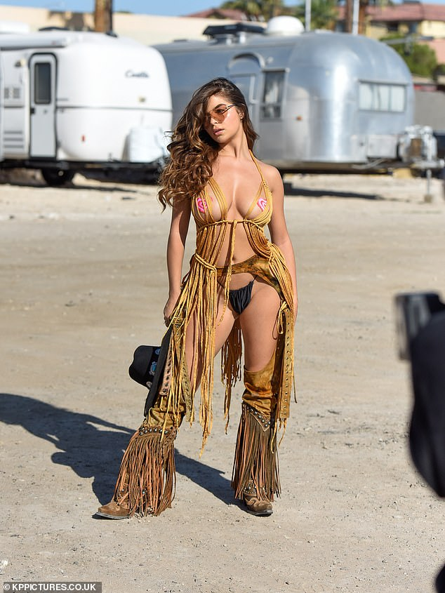 Hot stuff! The stunner, 24, was sure to turn heads during the appearance as she sizzled in front of the camera while wearing a perilously racy ensemble complete with shredded material and pasties to protect her modesty