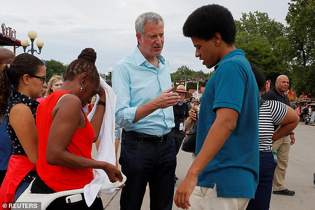 Bill de Blasio is joined by his wife Chirlane and his son Dante at the Iowa State Fair