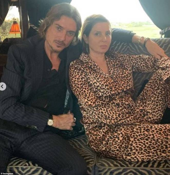 Happy days:Sadie, who was joined by her dapper boyfriend Darren Strowger, wore the same pyjamas - designed by London based fashion brand Yolke - and cosied up to her beau in a carriage