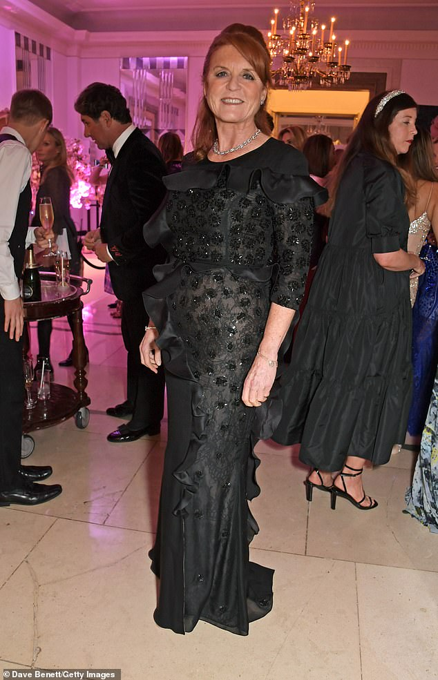 The Duchess wore the black floor length gown, which had a slit up the side with black heels and a silver patterned necklace
